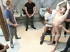 Gay fresh twink taking cocks in his palm overcoming his fear in bdsm gangbang sex in filthy lavatory